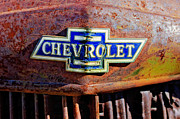 Rusty Car Photos - Chevrolet Grille Emblem by Jill Reger