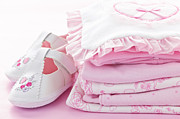 Baby Clothes Posters - Pink baby clothes for infant girl Poster by Elena Elisseeva
