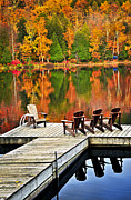 Foliage Framed Prints - Wooden dock on autumn lake Framed Print by Elena Elisseeva
