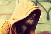 Artistic Hooded Portrait Photos - Young man portrait on graffiti grunge wall by Photocreo Michal Bednarek
