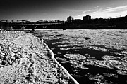 Sask Photo Posters - large chunks of floating ice on the south saskatchewan river in winter flowing through downtown Sask Poster by Joe Fox