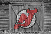 Puck Prints - New Jersey Devils Print by Joe Hamilton