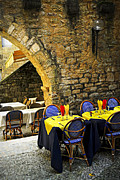 Historical Buildings Posters - Restaurant patio in France Poster by Elena Elisseeva