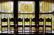 Flagler Framed Prints - 7 Chairs and Stained Glass Framed Print by Rich Franco