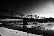 Sask Prints - the old traffic bridge over the south saskatchewan river in winter flowing through downtown Saskatoo Print by Joe Fox