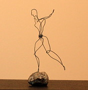 Jumping Sculptures - Man Jumping Rocks by Mel Drucker