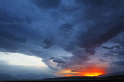 Storm Clouds Prints - Stormclouds and sunset above mountains at Toktogul in Kyrgyzstan Print by Robert Preston