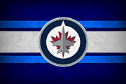 Puck Framed Prints - Winnipeg Jets Framed Print by Joe Hamilton