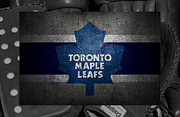 Puck Prints - Toronto Maple Leafs Print by Joe Hamilton