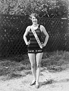 Swimsuit Photography Prints - A Bathing Suit With Advertising Print by Underwood Archives
