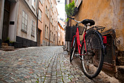 Old Wall Framed Prints - A bike in the old town of stockholm Framed Print by Michal Bednarek