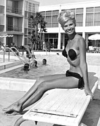 Skinny Framed Prints - A Blonde Wearing A Tri Kini Framed Print by Underwood Archives