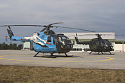 105 Posters - A Bo-105 Liaison Helicopter And A Nh90 Poster by Timm Ziegenthaler