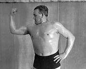 Body Builder Photos - A Body Builder Poses by Underwood Archives