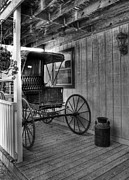 Carriages Photo Posters - A Buggy On A Porch bw Poster by Mel Steinhauer