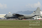 Featured Metal Prints - A C-130j Hercules Of The Royal Metal Print by Remo Guidi