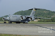 Featured Metal Prints - A C-17 Globemaster Iii Of The U.s. Air Metal Print by Remo Guidi