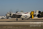 Featured Art - A C-2 Greyhound Lands On Naval Air by Stocktrek Images
