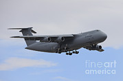 Featured Acrylic Prints - A C-5 Galaxy In Flight Over Nevada Acrylic Print by Remo Guidi