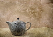 Oriental Teapot Framed Prints - A ceramic vintage teapot on bamboo mat Framed Print by Arisha Singh