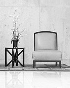 A Chair And A Table With A Plant  Print by Rudy Umans