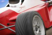 Formula Car Photos - A Close-up Of A Red Race Car by Don Hammond