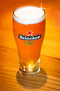 Draught Prints - A cold refreshing pint of Heineken lager Print by Semmick Photo