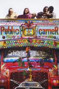 Knees Framed Prints - A Colorful Public Bus In Rajasthan Framed Print by Alan Williams