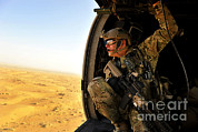 Featured Art - A Combat Rescue Officer Conducts by Stocktrek Images