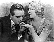 Movie Stars Photos - A Fingertip Nibble by Underwood Archives