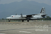 Featured Metal Prints - A Fokker F-27 Friendship Metal Print by Remo Guidi