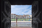 Dorsoduro Prints - A girl looking at the Grand Canal framed by the door of La Salute church Print by Felipe Rodriguez