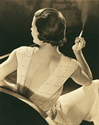 Evening Wear Photo Framed Prints - A Glamourous Woman Smoking Framed Print by Underwood Archives