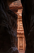 Treasury Framed Prints - A glimpse of Al Khazneh from the Siq in Petra Jordan Framed Print by Robert Preston