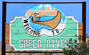 Green Canoe Prints - A Green River Welcome Print by David Lee Thompson