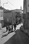 Narrow Streets Prints - A Group of Children in Kadifekale District in Izmir Print by Ilker Goksen