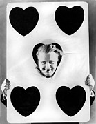 Playing Cards Framed Prints - A Happy Five Of Hearts Framed Print by Underwood Archives