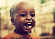 Problem Framed Prints - A laughing Tanzanian child Framed Print by Michal Bednarek