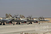 Military Strike Posters - A Line Of F-15i Raam Of The Israeli Air Poster by Ofer Zidon