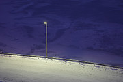 Snowy Night Night Photo Prints - A lonely lamp Print by Intensivelight