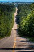 Asphalt Photos - A Long Road by Matt Dobson