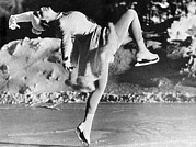 Figure Skating Photos - A Lovely Ballet Pose on Ice Skates by Underwood Archives