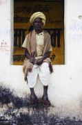 Rajasthan Prints - A Man In Clogs Sitting In A Window In Print by Alan Williams