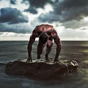Strength Photo Posters - A Muscular Man In The Starting Position Poster by Ben Welsh