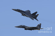 Featured Metal Prints - A Pair Of F-15c Eagle Aircraft Perform Metal Print by Remo Guidi