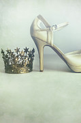 Sandra Cunningham - A pair of high heel shoes with a crown