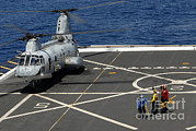 Featured Art - A Plane Captain Signals To A Ch-46e Sea by Stocktrek Images
