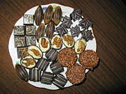A Plate Of Chocolate Sweets Print by Ausra Paulauskaite