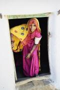 Entrance Door Framed Prints - A Rajput Woman Leaving A Building Near Framed Print by Alan Williams