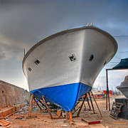 Pier Digital Art - a resting boat in Jaffa port by Ron Shoshani